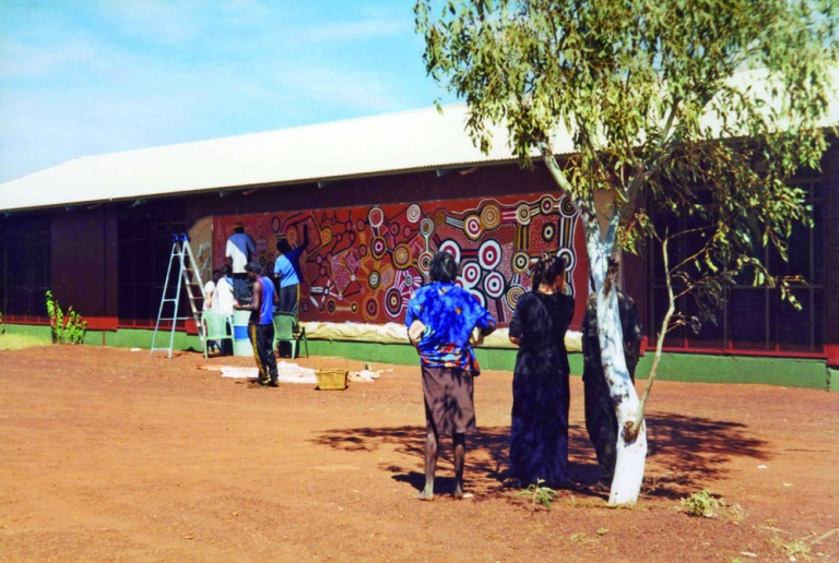 Reproduction of old men's [1981] banner, on the side of the Warlayirti Arts centre, 2001