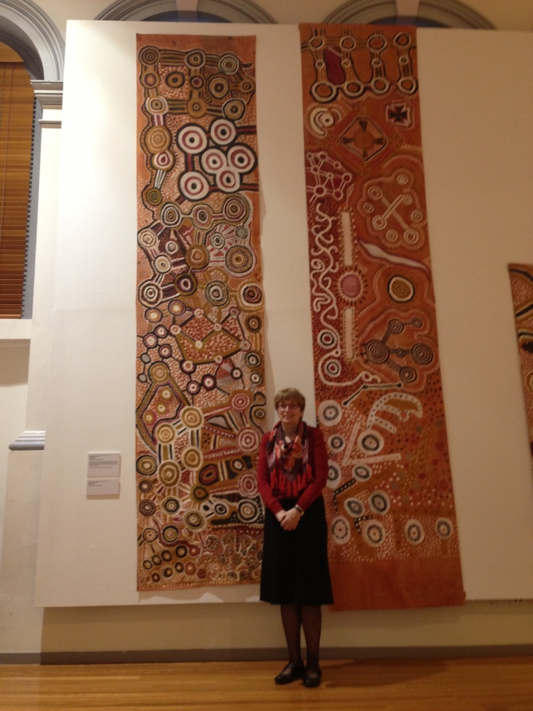 Seen for the first time for public display since they were painted in 1981, exhibition curator Dr Jacqueline Healy with the Assembly Banners at RMIT Gallery as part of the exhibition Warlayirti: The Art of Balgo (16 September - 8 November)