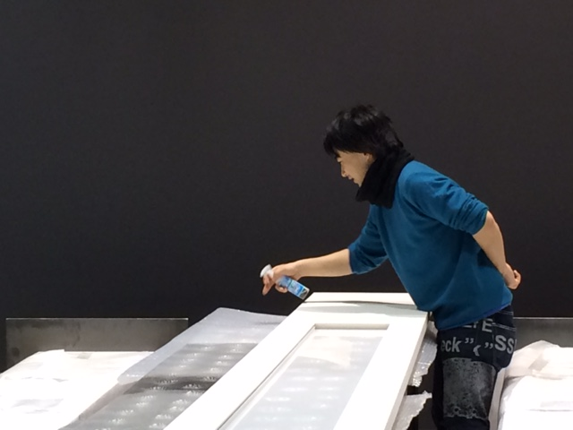 Japanese artist Ei Wada at RMIT Gallery installing his work Falling Records