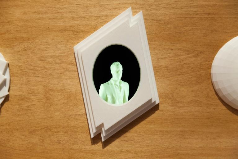 Cake Industries, Simulacrum 2014 3D printed portraits, frame, LED lights, motors 92 x 130 x 25 cm