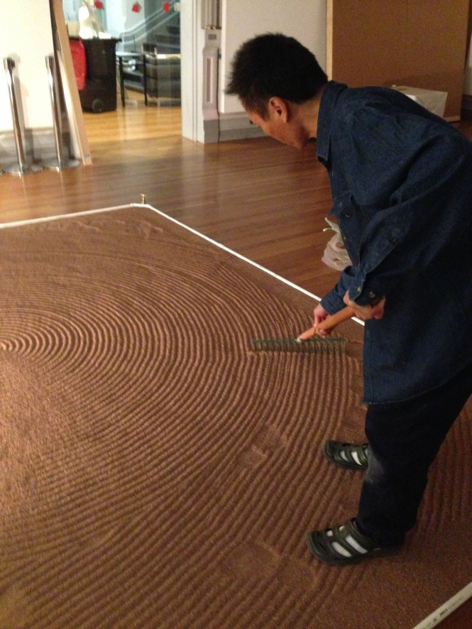 Artist Yutaka Kobayashi at work at RMIT Gallery on his installation 'Absorption Ripples' for RMIT Gallery's exhibition Japanese Art After Fukushima: Return of Godzilla - official opening 6-8 pm Thursday 26 March 2015.