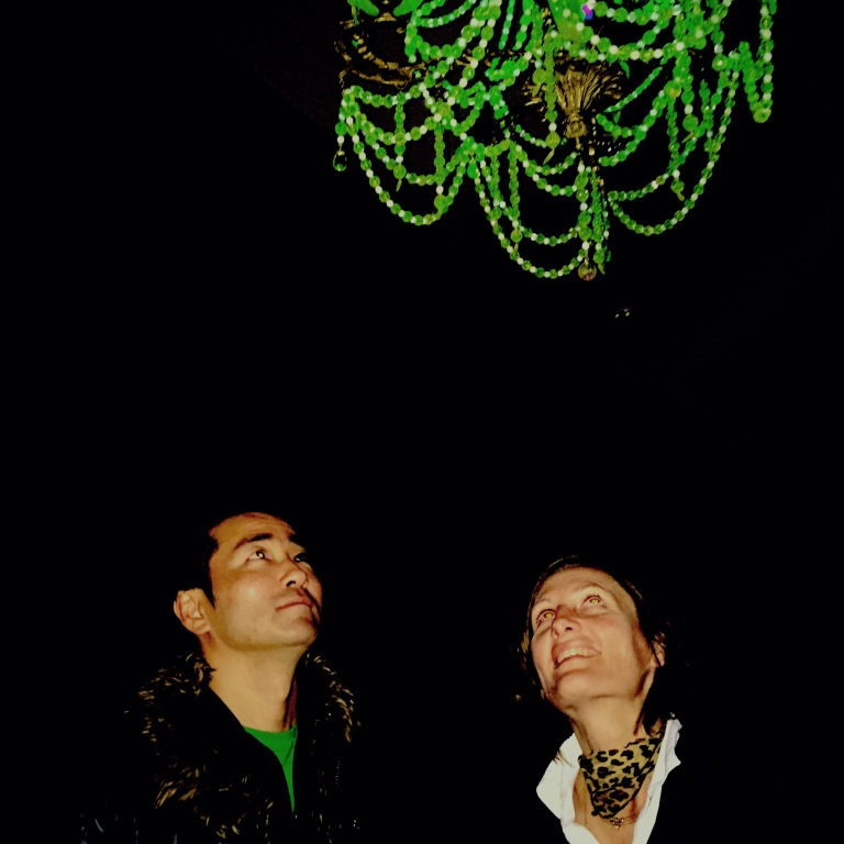 Ken and Julia Yonetani under the 'Crystal Palace' chandelier made from depleted uranium crystal and sourced from the Internet. Photo: Evelyn tsitas