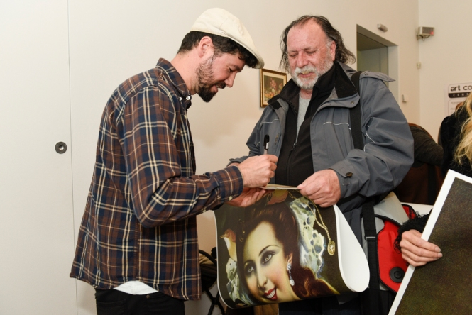 Get your free artwork at Power to the People! - RMIT Gallery is giving away large color posters of Spanish artist Julio Falagán's work (pictured, left). Photo: Vicki Jones Photography
