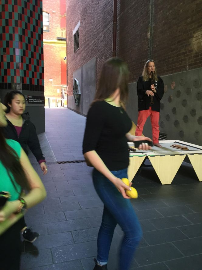 Brian Ritchie, Violent Femmes' bass player -  performing portable komuso temple compositions at RMIT University, in the laneway between RMIT Gallery and Building 8. Photo Evelyn Tsitas