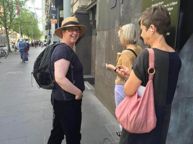 UK artist Dierdrie Heddon takes participants on a guided audio-walk from RMIT Gallery. Photo: Evelyn Tsitas